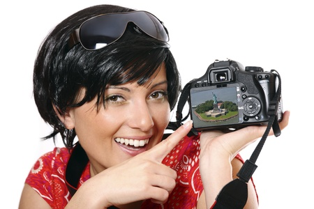 A picture of a cute girl showing her pictures on the camera, contributor has the rights to the picture on the camera photo