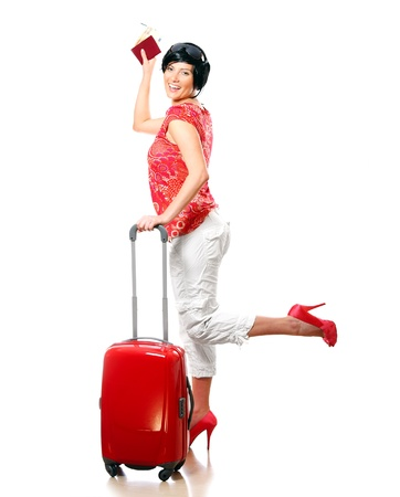 A picture of a pretty, happy woman with a red suitcase going on holidays Stock Photo - 8905317