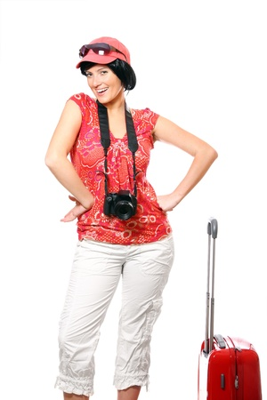 A picture of a happy woman with camera and suitcase ready to go on holidays Stock Photo - 8905320