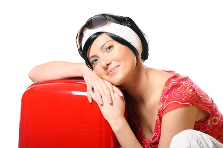 A picture of a happy woman resting on a red suitcase ready to go on holidays Stock Photo - 8905343