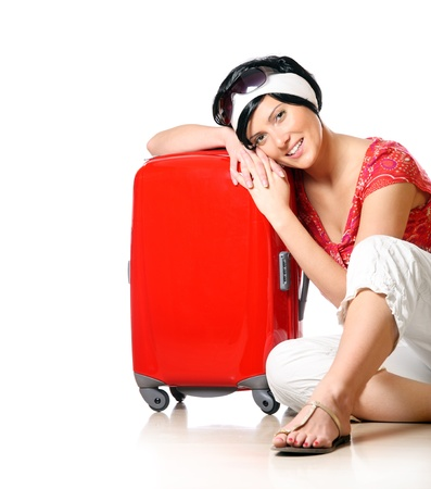 A closeup of a pretty girl in short black hair resting on a suitcase over white background Stock Photo - 8905354