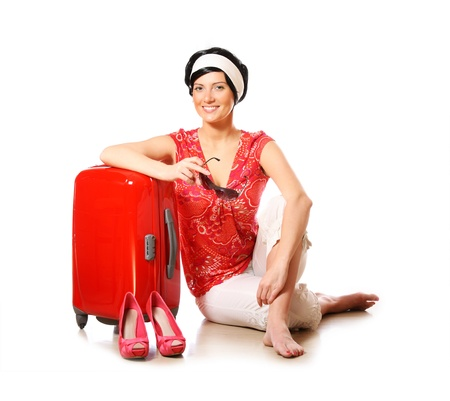 A picture of a happy woman ready to go on holidays photo