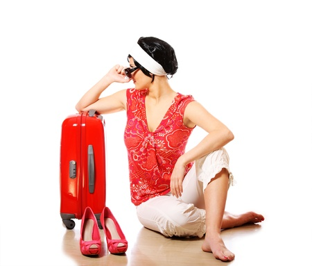 A picture of a young woman packed and looking forward to going on holidays Stock Photo - 8953232