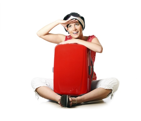 A picture of a young woman packed and looking forward to going on holidays photo