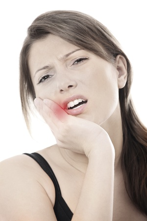 A picture of a young woman with a terrible toothache