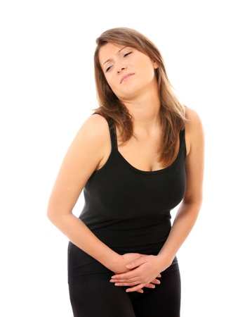 uncomfortable: A picture of a young woman suffering from stomach ache against white background Stock Photo