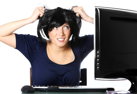 A portrait of a frustrated young businesswoman pulling out hair over white background Stock Photo - 9046582