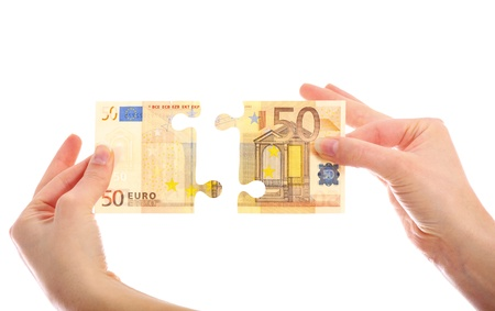 euro bill: A picture of a fifty-euro note jigsaw puzzle over white background