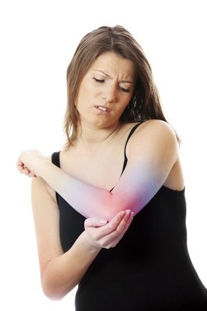 codo: Una foto de una mujer joven que sufren dolor de codo sobre fondo blanco Foto de archivo