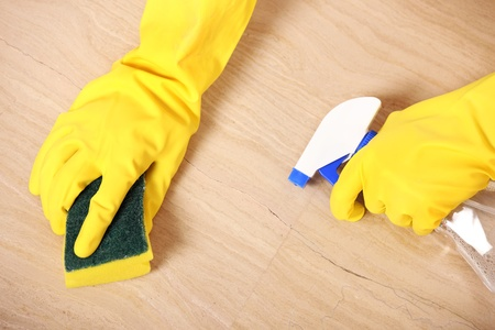 housekeeper: A picture of hands in yellow gloves cleaning the floor  Stock Photo