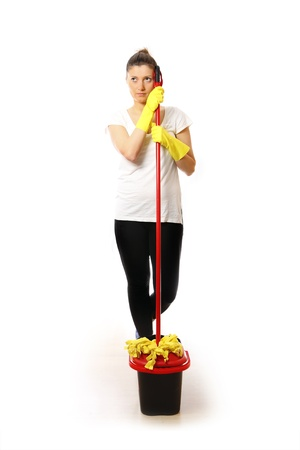 A picture of a young woman standing with mop and bucket over white background photo