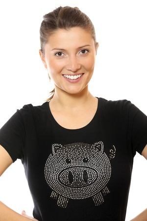A picture of a young pretty woman in a black t-shirt with a sequined pig over white background Stock Photo - 9112878