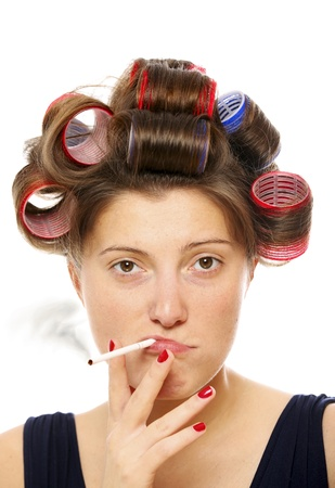curler: A portrait of an ugly woman smoking against white background