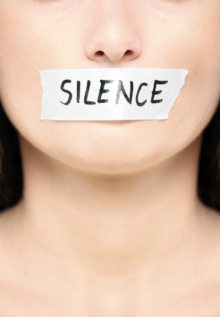 A picture of a female face with a tape on her mouth and a notice silence photo
