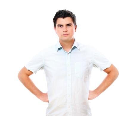 A portrait of a young handsome serious man standing over white background photo