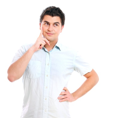 A portrait of a young handsome man thinking over white background photo
