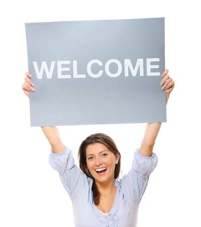 welcome people: A portrait of a young happy woman holding a banner over white background Stock Photo
