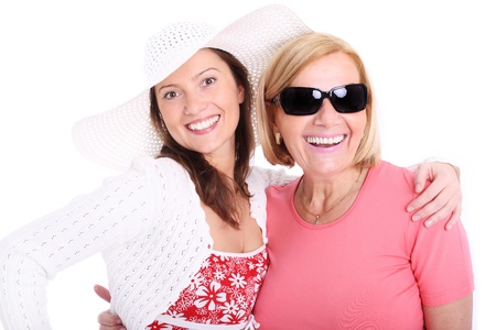 A picture of a mother and daughter smiling over white background Stock Photo - 9693651