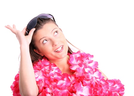A picture of a happy woman in a hawaiian necklaces dreaming over white background photo