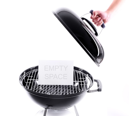 A picture of a new black grill and a hand holding the cover. Ready space for some text Stock Photo
