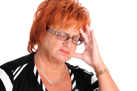 A portrait of a middle-aged lady having headache over white background photo