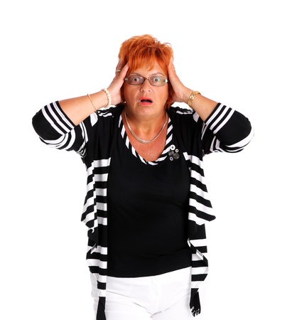 A portrait of an attractive woman in her fifties being surprised over white background photo