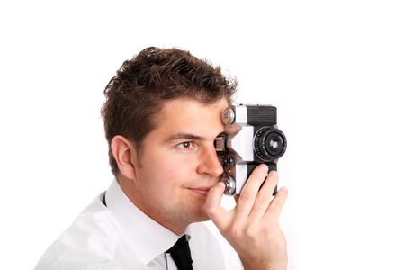 A picture of a young man trying to take a picture against white background Stock Photo - 9886766