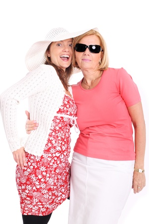 A picture of a mother and daughter smiling over white background Stock Photo - 9886778