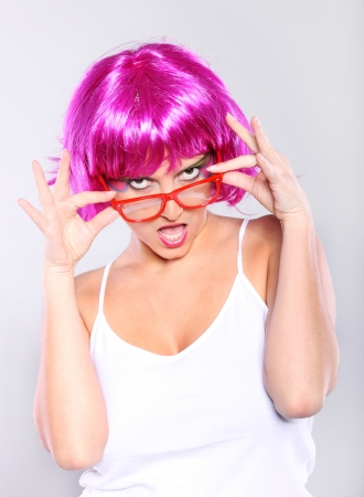 funny glasses: A picture of a young woman in purple hair and red glasses over white background