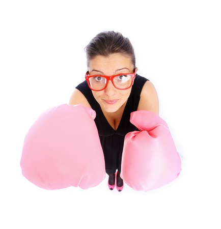 A picture of a young female office worker standing against white background in pink gloves photo