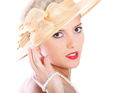 A picture of a beautiful woman in a red lipstick and a hat over white background photo