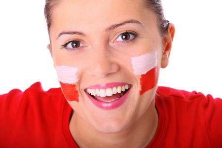 bandera de polonia: Una imagen de un ventilador mujer polaca feliz animando sobre fondo blanco Foto de archivo