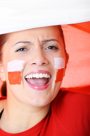 A picture of a happy Polish female fan cheering against Polish flag Stock Photo