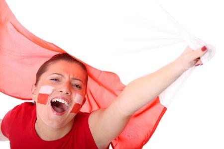 polish flag: A picture of a happy Polish female fan cheering against Polish flag Stock Photo