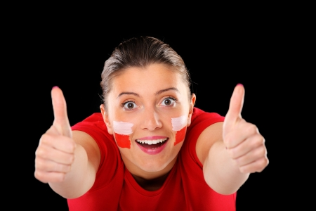 A picture of a happy Polish female fan showing