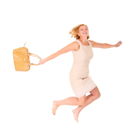 running camel: A portrait of a fashionable woman with a bag ready for shoping jumping over white background Stock Photo