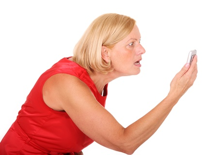 A picture of an angry woman shouting at her cell phone over white background photo