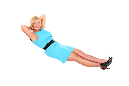 levitating: A picture of an attractive mature woman levitating against white background