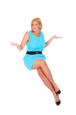 A picture of a beautiful blond woman with long legs sitting in the air over white background Stock Photo