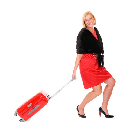 A picture of an attractive woman in her fifties walking over white background with a suitcase Stock Photo - 10057584