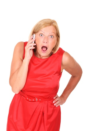 A picture of a surprised woman with a cell phone over white background Stock Photo - 10057586