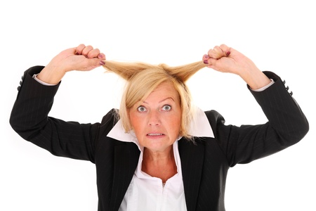 A portrait of a mature frustrated woman pulling out hair over white background Stock Photo - 10112616