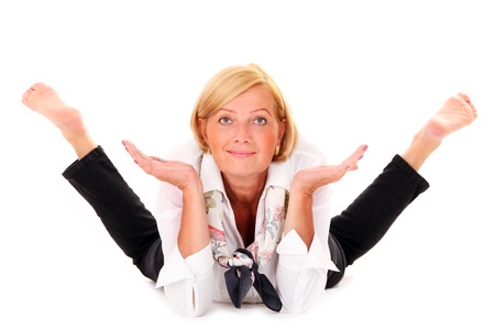 foot model: A picture of a mature flexible woman lying over white background Stock Photo