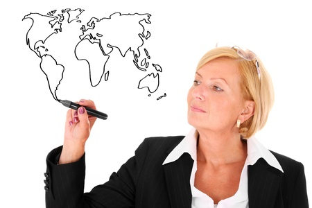 A portrait of a mature beautiful woman drawing a world map over white background