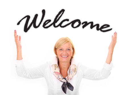 A picture of an attractive mature woman with her hands up in a welcoming gesture over white background Stock Photo