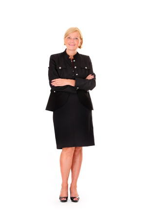 business woman standing: A portrait of a beautiful confident woman standing over white background