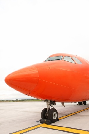 A picture of an orange business jet standing on the apron space for your text Stock Photo - 10179052