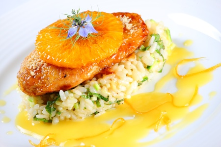 A picture of a marinated orange chicken served with rice and sauce Stock Photo - 10601341