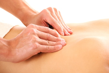 A picture of male hands giving a back massage over white background