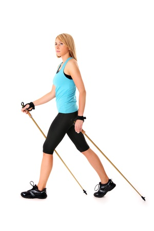 A picture of a young woman practising nordic walking over white background Stock Photo